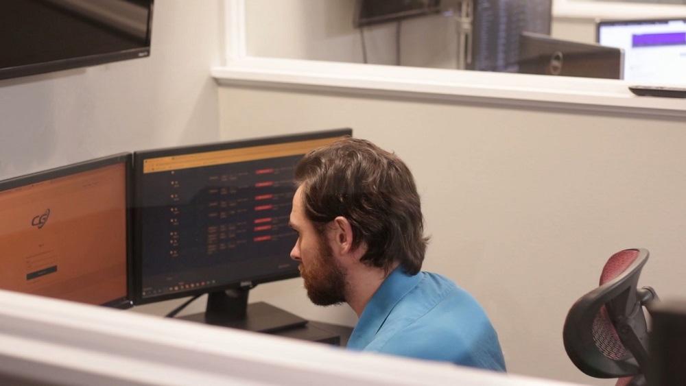 Technician sitting at his desk providing remote computer support